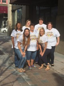 The Lacy Katzen team volunteering at CURE