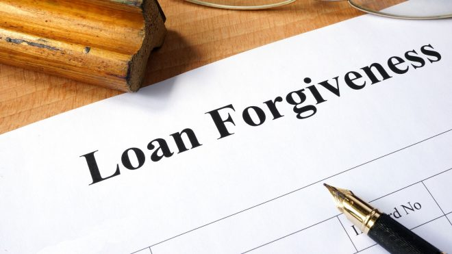 Document titled Loan Forgiveness on a table.